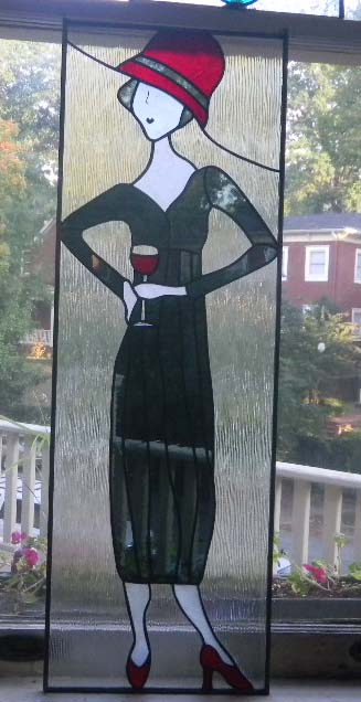 stained glass lady with red hat